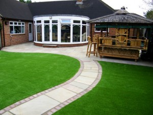 Sandstone and grass patio