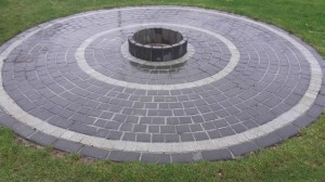 cobble circle with flower bed centre