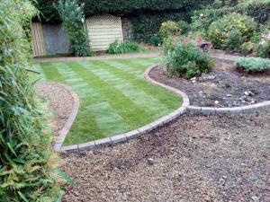 garden paving with roll on grass