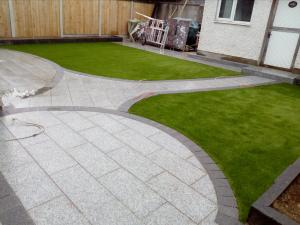 silver granite patio with artificial grass