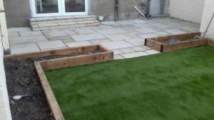 Sandstone paving and grass