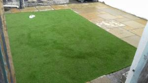Artificial grass and limestone patio